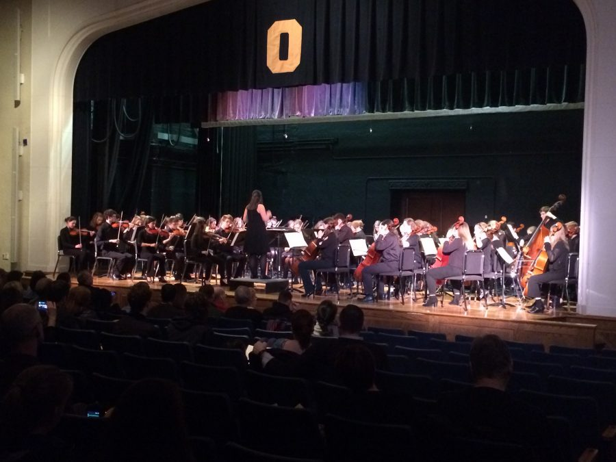 """The symphony orchestra holds student performers from grades ten throught 12. Meredith Depew led the symphony orchestra through pieces such as """"New World Symphony""""."""