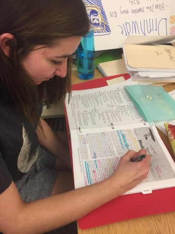 Jordan Neeley (11), a member of the Honors team, studies to prepare for her second Nationals competition.