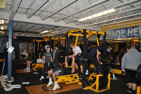 Lifting performances: Members of the OHS football team congregate in the weight room after school for practice and to increase strength and endurance.