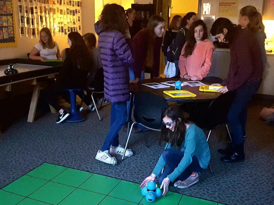Convivial Coding: The new Girls Who Code club kicked off their first meeting with English teacher Ann Whitehair's programming robots.