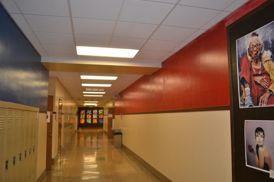 Hallway Hues: The sides of the freshman hallway are painted in red and blue in preparation for displaying art along the walls.