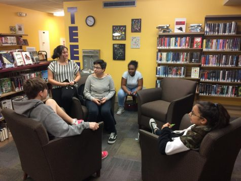 Diamond Martinez (10), center, and friends sit in the teen area at Wright Memorial Library to relax and talk after school.