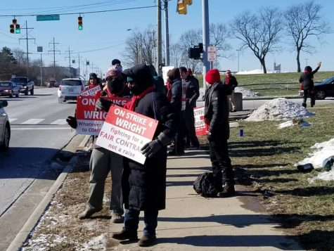 Sidewalk standoff: Union members and supporters participate in picketing for the strike on the Wright State campus.