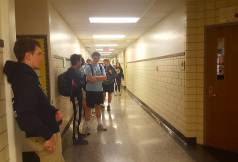 Awaiting assessment: Sophomore students wait outside a classroom to take a state-required English test.
