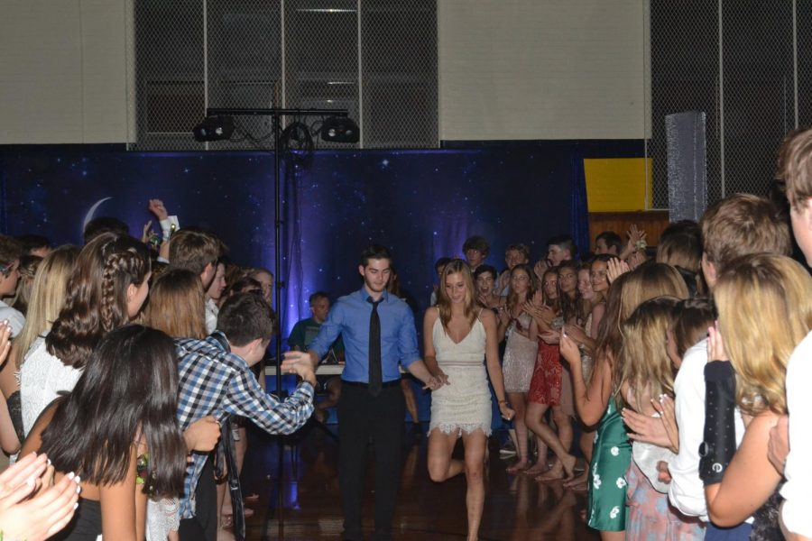 New aisle: Students make their way for  senior homecoming king and queen Luke Wilson and Kathleen Conrath make their way down the aisle.