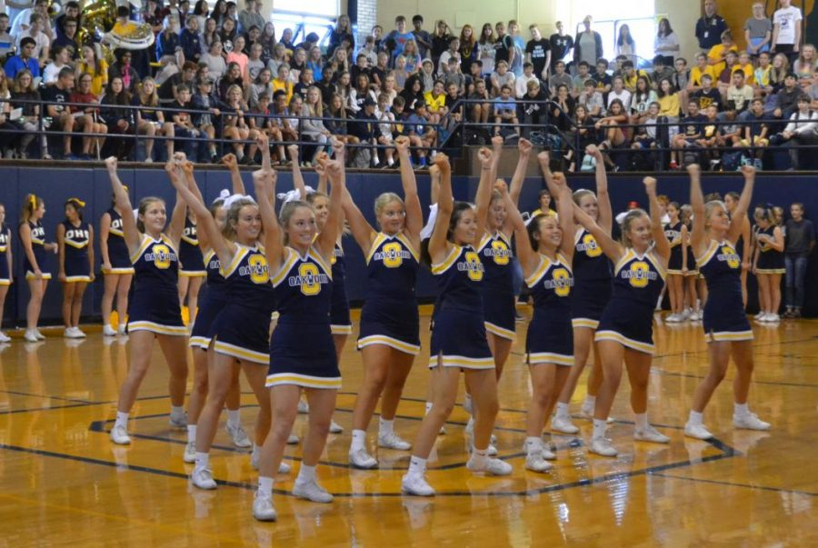 Cheering on: The varsity cheerleaders perform their routine in the pep rally to kick off homecoming weekend. Photo by: Sasha Gurevich
