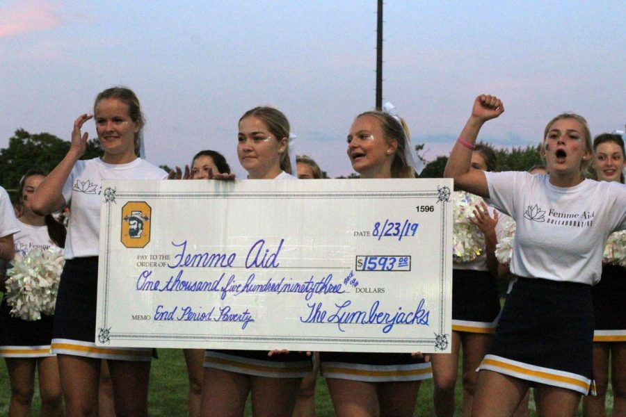 Checked Off: The leaders are enthusiastic about the check that they received as a representation of their accomplishment at the Jamboree football game. That night, the ladies of Femme Aid held a fundraiser to offer community members a chance to support those in need. At the end of the night, the ladies collected approximately $1,600. Photo contributed by Audrey Bergeron.
