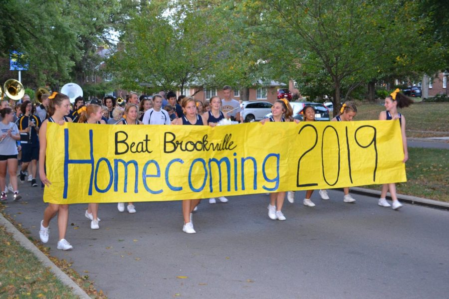 Leading ladies: Cheerleaders march at the front the parade on Oct. 2. Photo by: Alex Thoma
