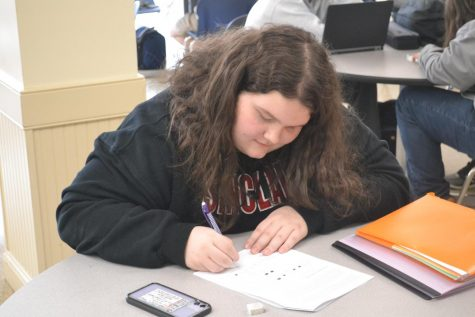 Going viral: American Sign Language student Maia Bisceglia (10) sits in study hall after all ASL classes were cancelled on March 12. Because of the recent outbreak of the coronavirus, Sinclair Community College, which is associated with ASL classes at the high school, closed and canceled classes, affecting CCP classes as well.