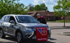 Era ends: Mark Brooks Hedstrom helps with the senior parade on May 26. Photo by: The Ax Staff