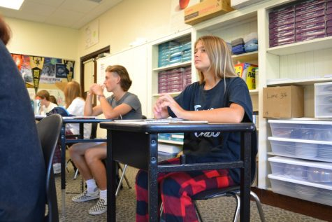 """Studious Spirit: During Pajama Day, Ashley Bowden (9) is focused in Jay Lane's fifth  period class. """"My favorite day was Jersey Day."""" Bowden said."""