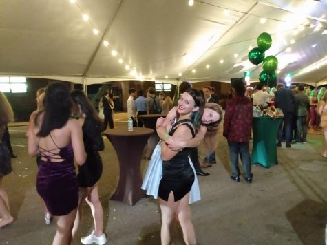 """Harmonious Hug: Lilli Jacobsen and Sofia Parrillo continue to enjoy themselves whilst on the outskirts of the dancefloor. Jacobsen (12) said, """"I actually liked having the dance outside."""""""