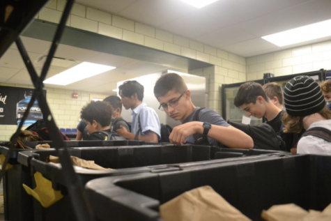 Binning Bags: The cafeteria is now lined with black containers, which consist of bags of lunch assortments.